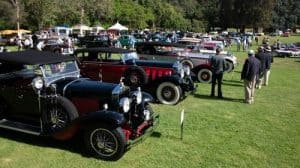 classic and vintage cars outdoors with spectators at the san marino motor classic