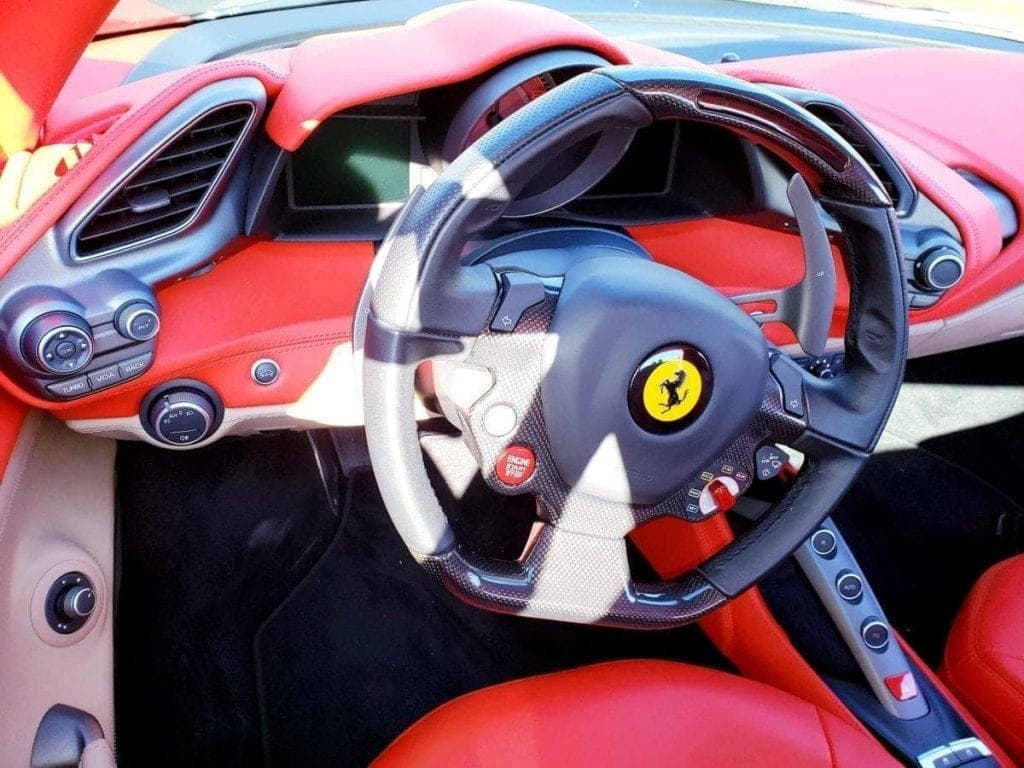 Red Ferrari 488 GTB steering wheel and dashboard