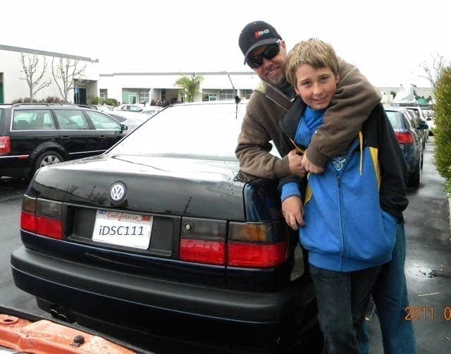 Jimmy Willhide hugging his son in front of one of his VW's