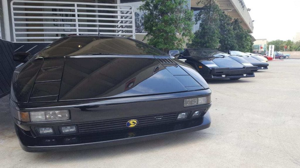 Row of black Lamborghini's parked outside the Marconi Automotive Museum
