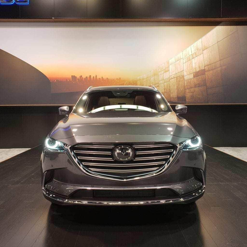 Front-facing view of a silver 2019 Mazda CX-9 at the Orange County International Auto Show