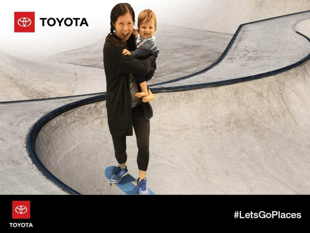 Tom Smith's wife & baby at the Toyota green-screen skate park during the Orange County International Auto Show