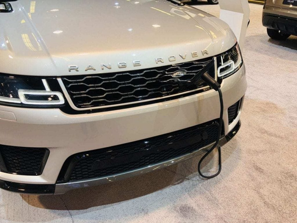 Close-up pic of the front of a 2019 off-white Range Rover Plug-in Hybrid referred to as a PHEV at the Orange County International Auto Show