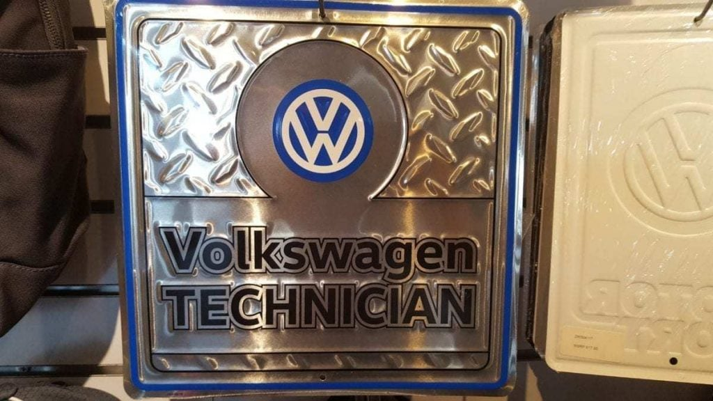 Metallic sign w/ VW logo and
