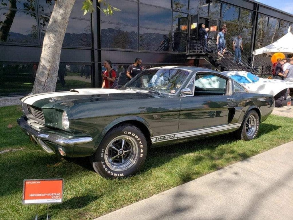 Dark green Ford Mustang G.T. 350 parked in the grass at the ArtCenter Car Classic 2018