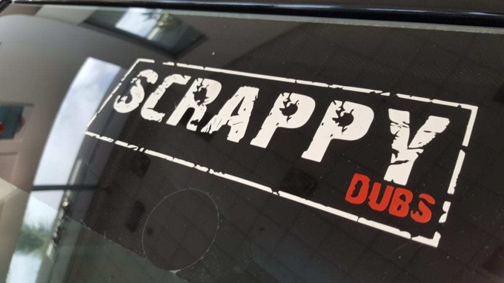 Close-up of an official mark window sticker for Scrappy Dubs Car Club