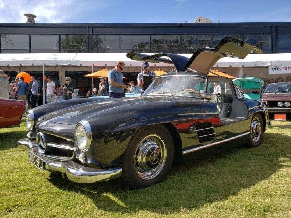 Dark gray classic Mercedes-Benz Gullwing parked in the grass at the ArtCenter Car Classic