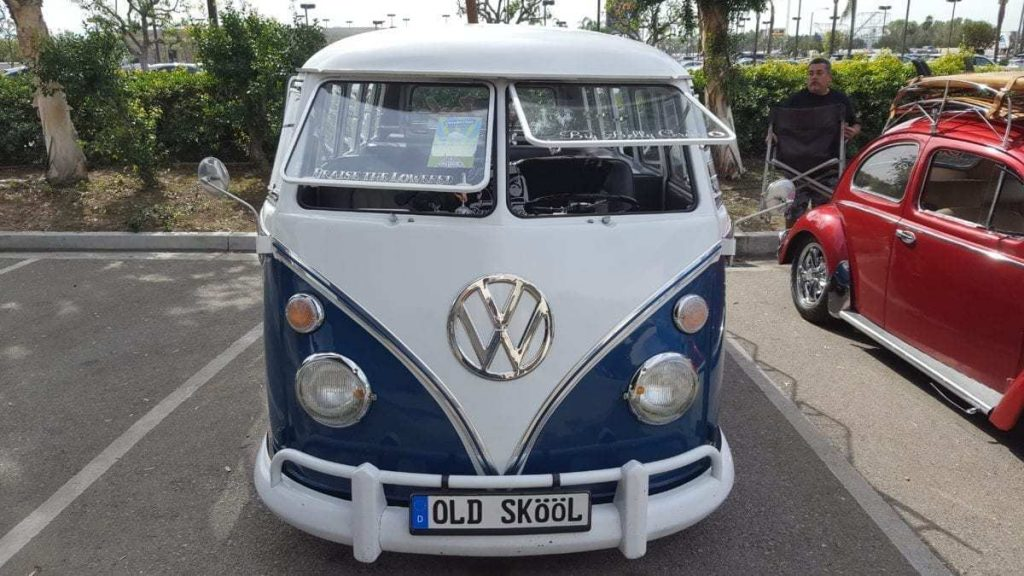 Front facing white and blue classic custom VW Window Bus