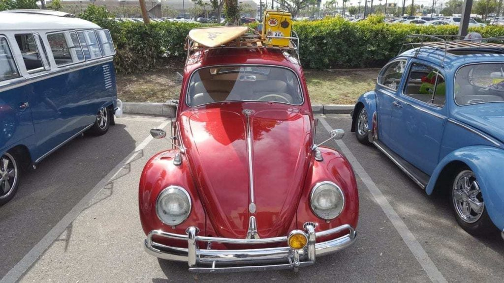Front facing classic custom red VW Bug parked at Ontario Volkswagen during Oktoberfest