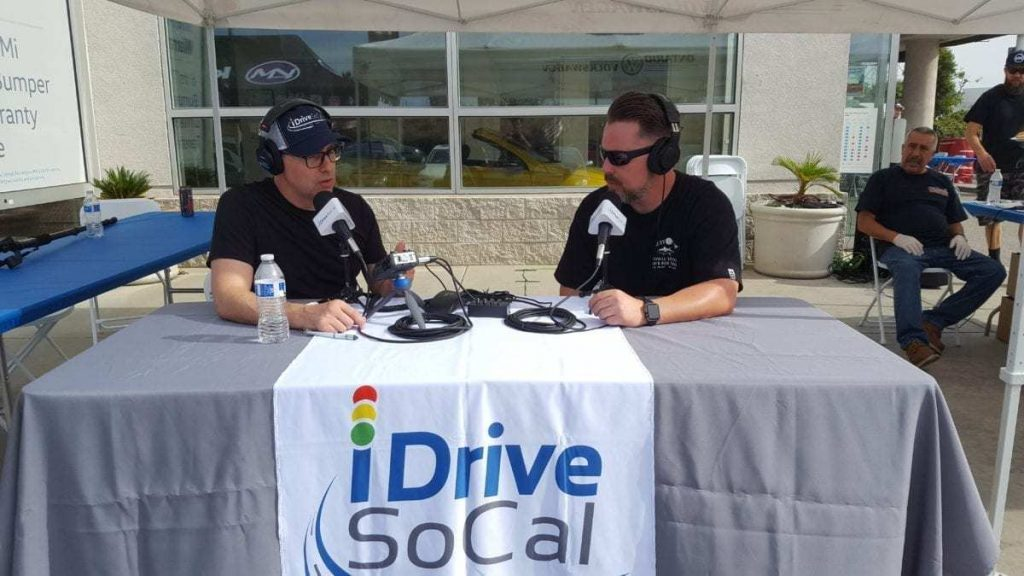 iDriveSoCal's Tom Smith interviews Scrappy Dubs Car Club's, Mike Pitman during Ontario VW's Oktoberfest Auto Show