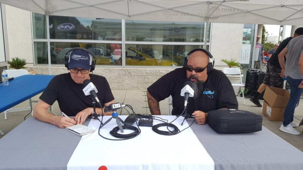 iDriveSoCal's Tom Smith interview's Danny Aceves of Old Skool Car Club during Oktoberfest Auto Show at Ontario Volkswagen