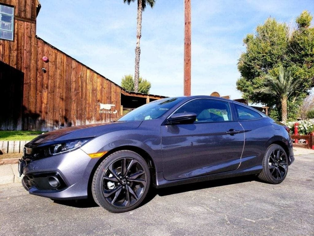 2019 Honda Civic Coupe review - gray driver-side front profile
