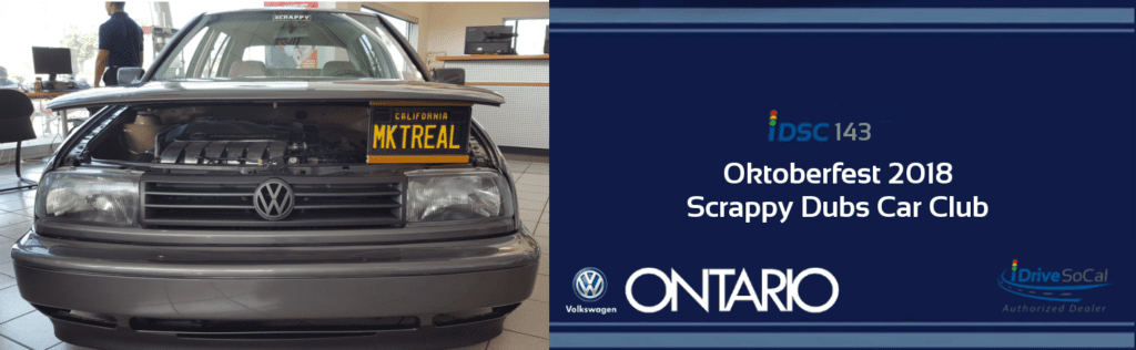 Forward facing custom Volkswagen parked inside Ontario VW with license plate propping up hood