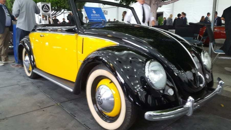 Black w/ yellow sided 1949 Volkswagen Beetle Hebmuller Cabriolet Passenger-front profile