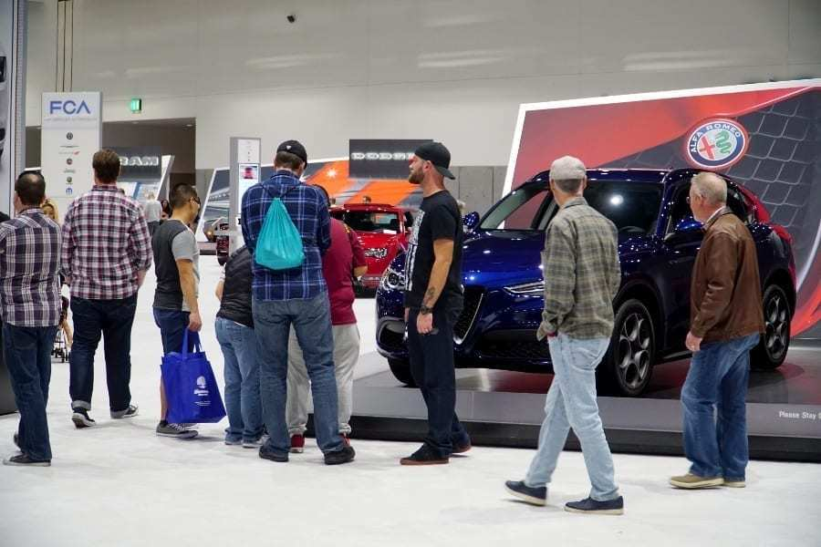 People gathered at the FCA, Dodge, Alpha Romeo booths of the San Diego International Auto Show