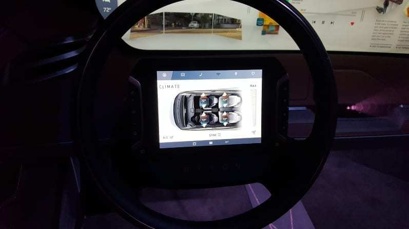Byton M-Byte Concept Digital Steering Wheel Display showing climate status for each of the vehicle's four seats