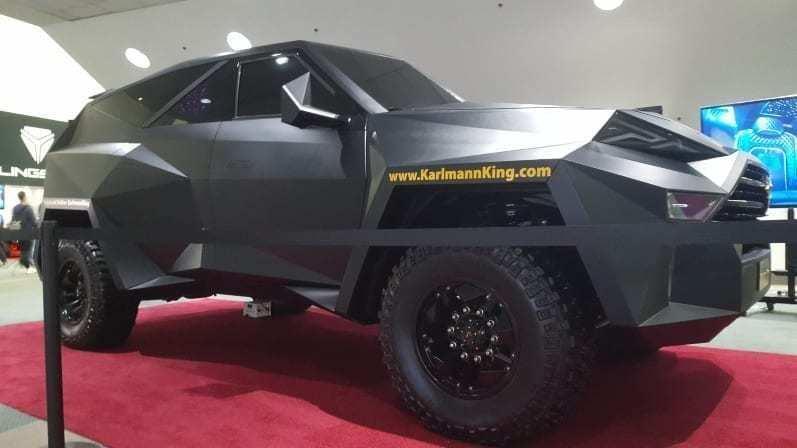 Karlman King Passenger-side Profile - Looks like cross between a stealth bomber and a SUV Batman would drive