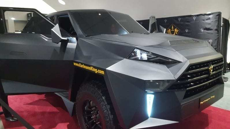 Karlman King Passenger-side front-view - Looks like a cross between a stealth bomber and Batman's tank-like SUV