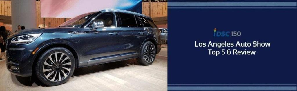 Metallic blue Lincoln Aviator pictured at the LA Auto Show as part of the iDriveSoCal 150 Podcast banner promoting the LA Auto Show Top 5 and Review