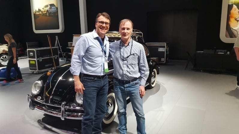 iDSC's Tom Smith & VW of America's Mark Gillies in front of a vintage black Volkswagen Beetle