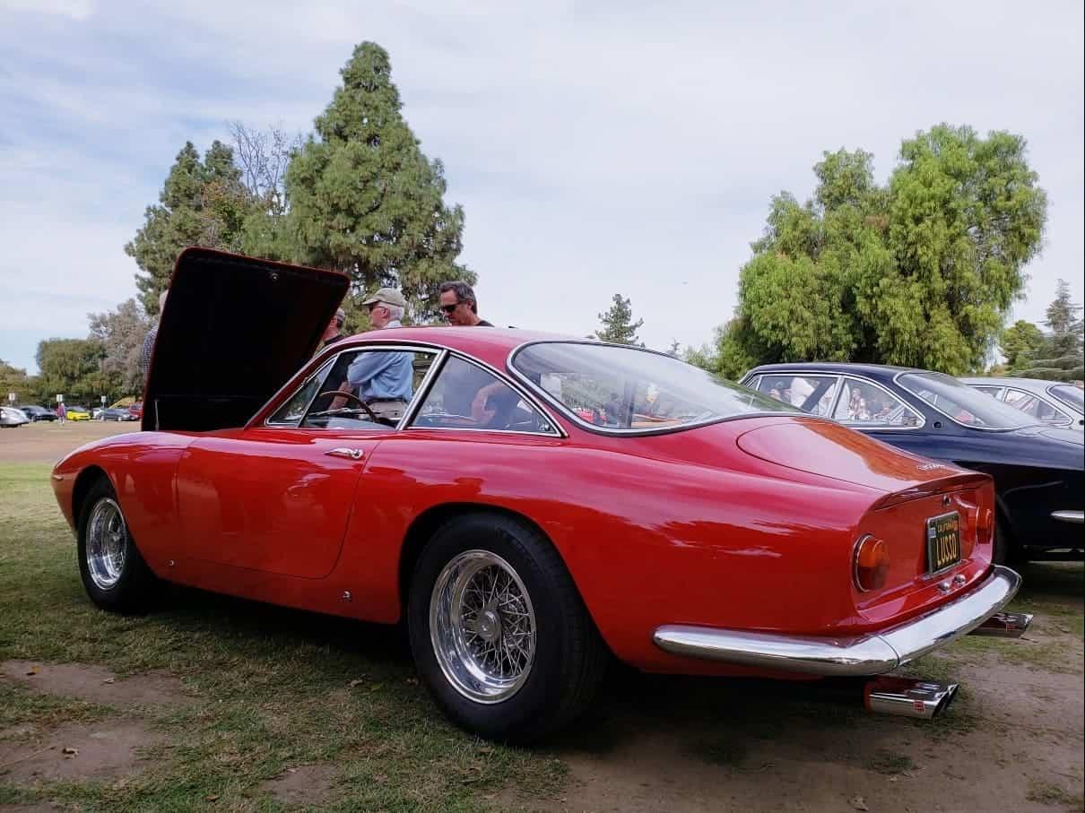 Red European car w/ hood up