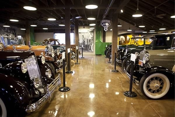 classic cars lined up inside the building of Motte Historical Museum and Motte Country Plaza