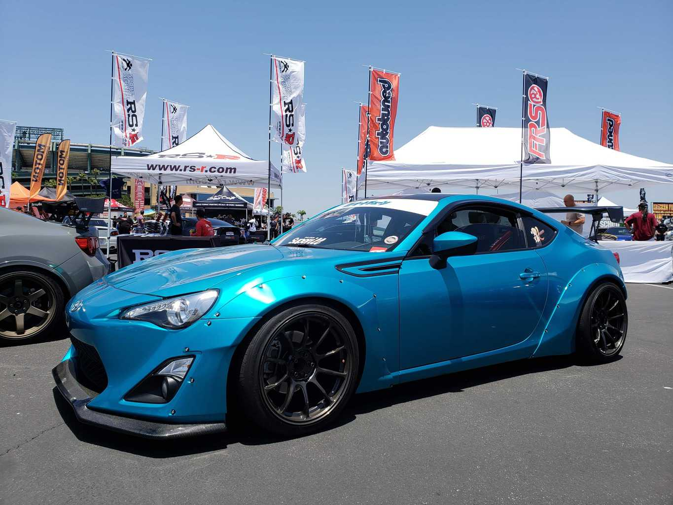 Front driver-side profile of a blue Toyota 86 import tuner car