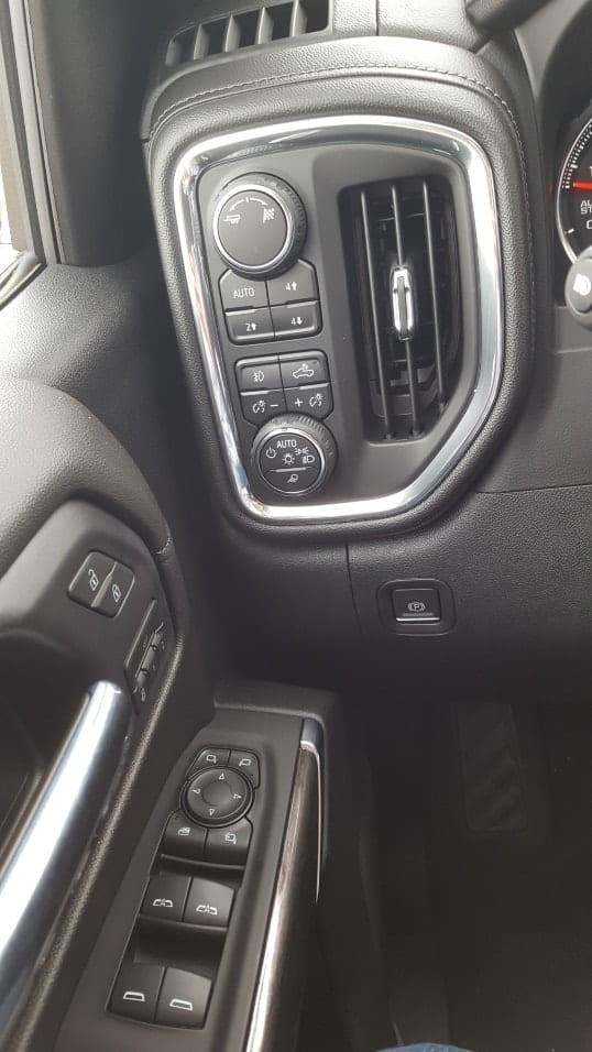Left of steering wheel 2019 Chevrolet Silverado 1500 driver door controls