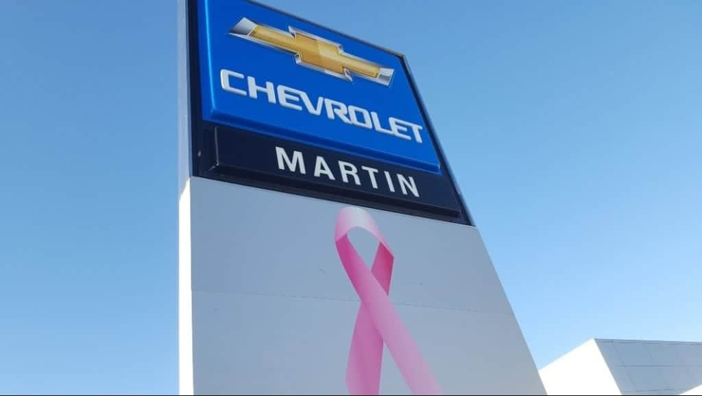 Martin Chevy sign w/ pink awareness ribbon