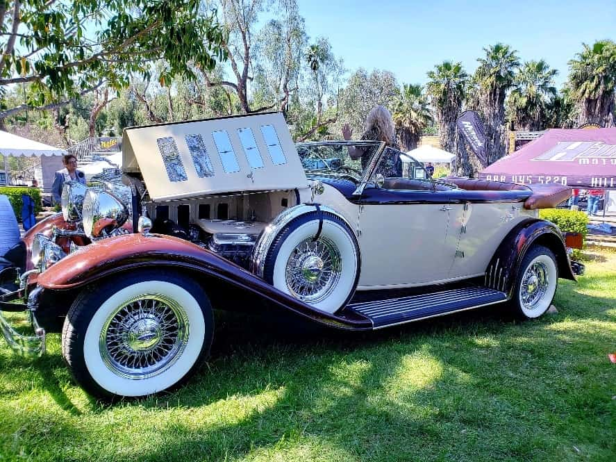 Folding hood open showing chromed engine of classic cabriolet