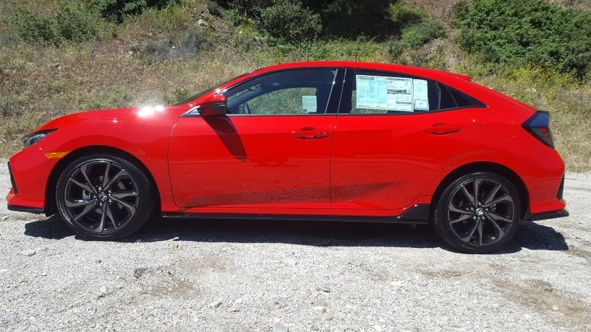 Red 2019 Honda Civic hatchback driver profile