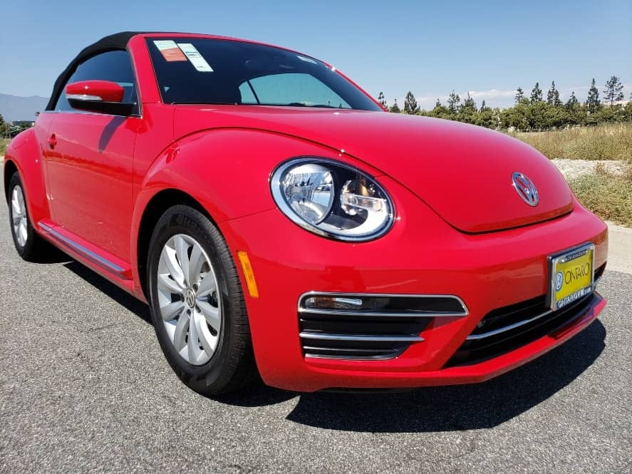 Red 2019 VW Beetle Convertible w. top up passenger front