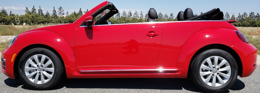 Red 2019 VW Beetle convertible w. top down driver profile banner