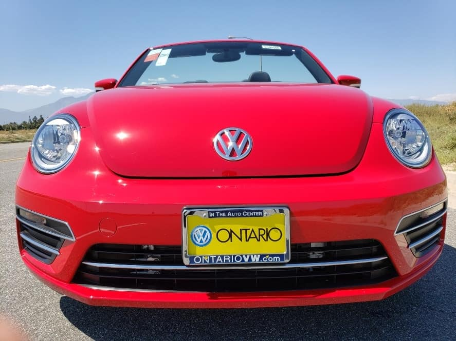 Red 2019 Volkswagen Beetle Convertible w. top down driver front