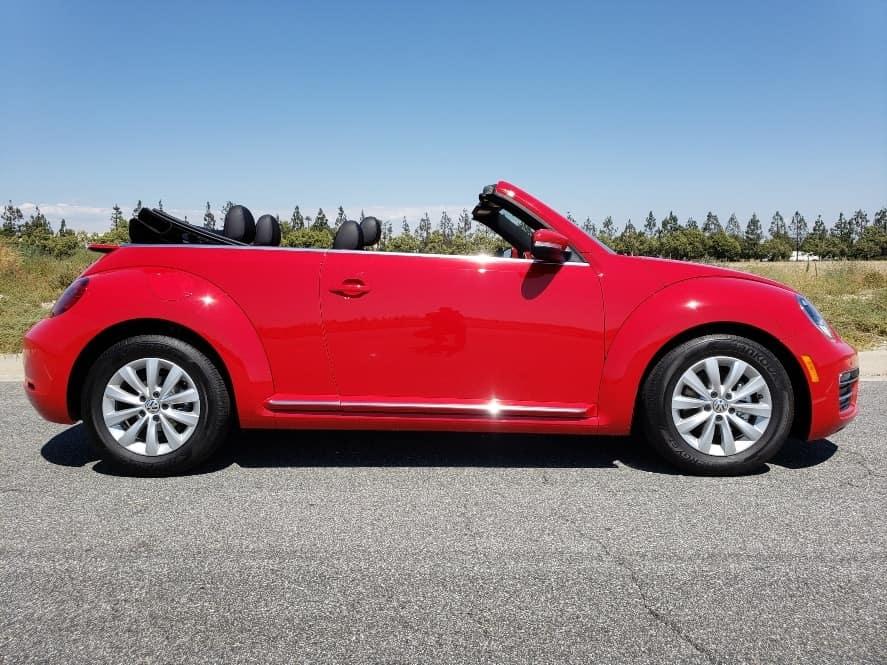 Red 2019 Volkswagen Beetle Convertible w. top down passenger profile