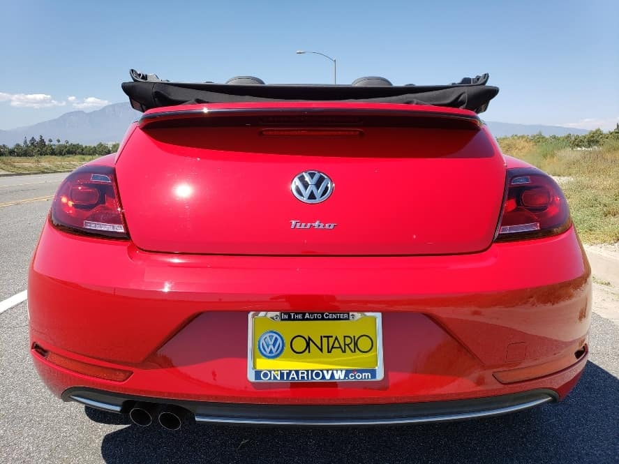 Red 2019 Volkswagen Beetle Convertible w. top down rear