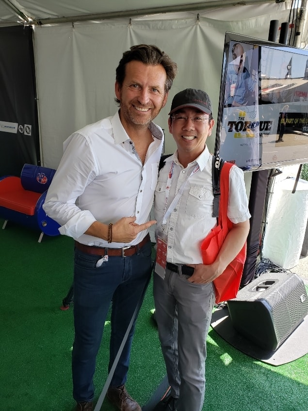 Former driver Justin Bell and Professor Quan at the Long Beach Grand Prix