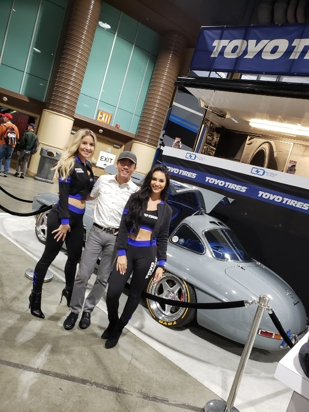 Professor Quan flanted by Lovely Car-Gals at the Lifestyle Expo during Long Beach Grand Prix