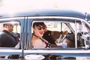 Pin-up Girl Riding with Two men in classic car Route 66 Cruisin' Reunion