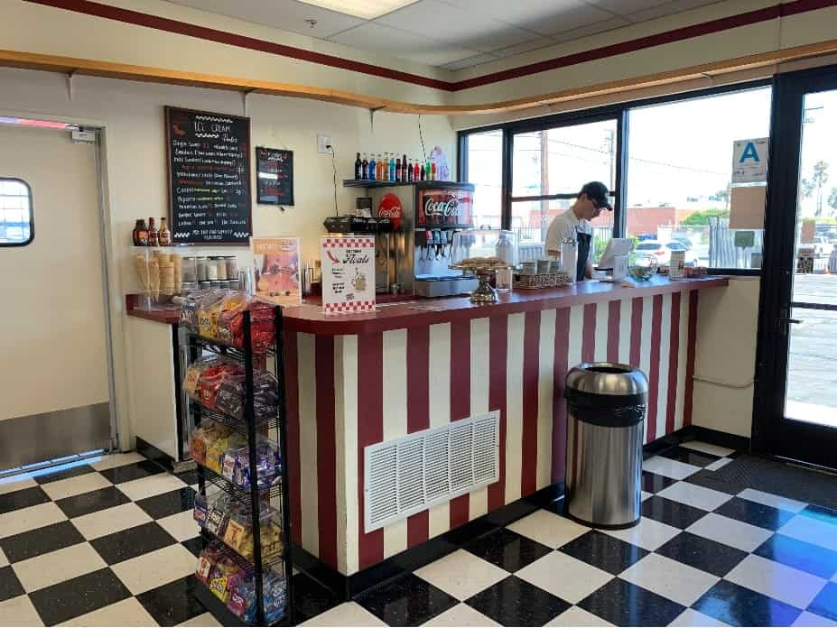 Soda jerk behind the counter of an old fashion ice cream parlor
