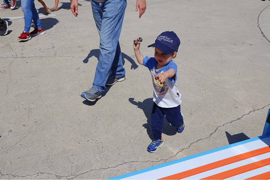 Toddler Smith runs to a toy race track
