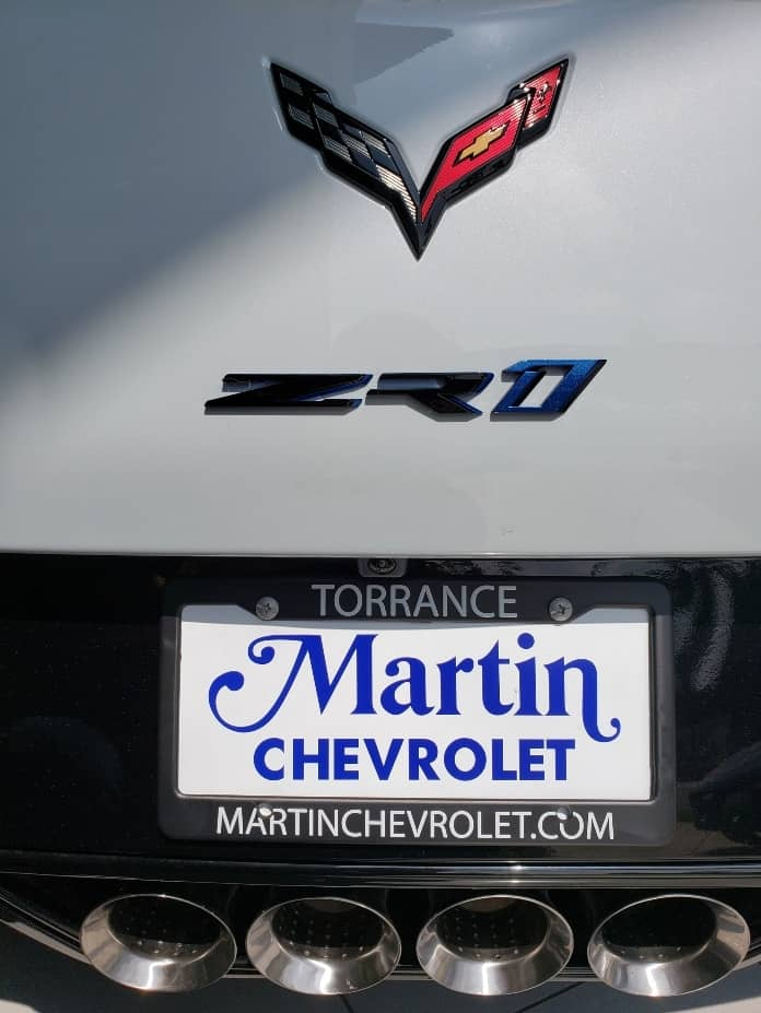 Corvette flags, ZR1 badge, Martin Chevrolet plate and 4x exhaust pipes