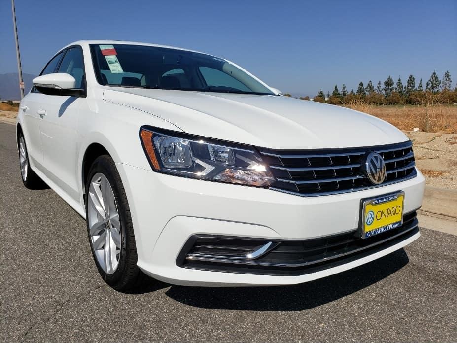 White 2019 VW Passat passenger front