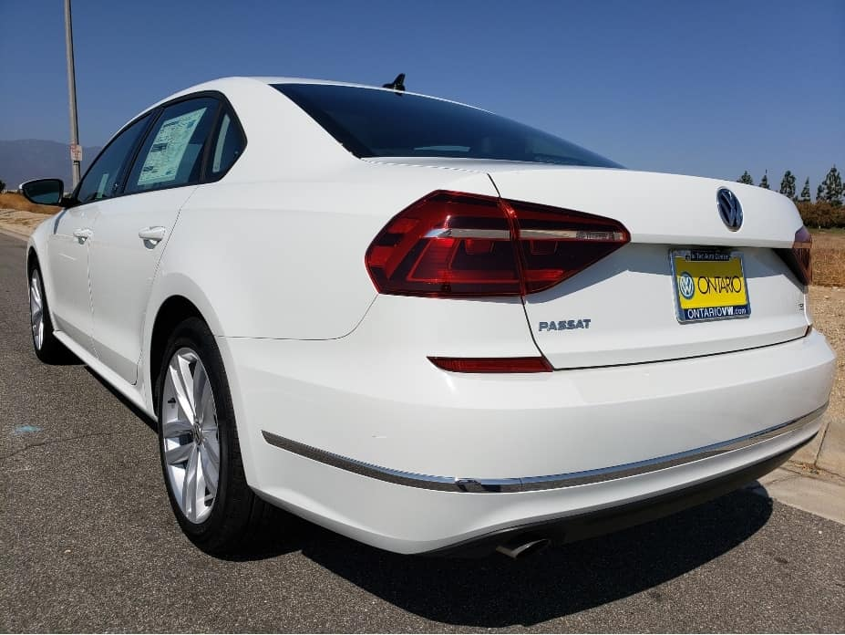 White 2019 VW Passat driver rear