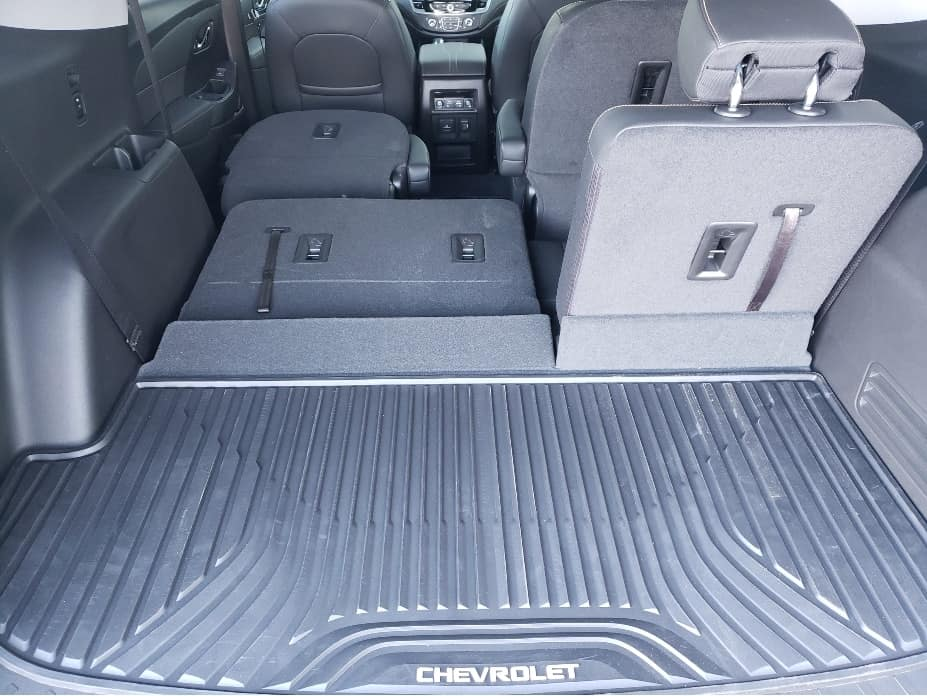 2020 Chevrolet Traverse cargo area with 2nd and 3rd row seats partially down