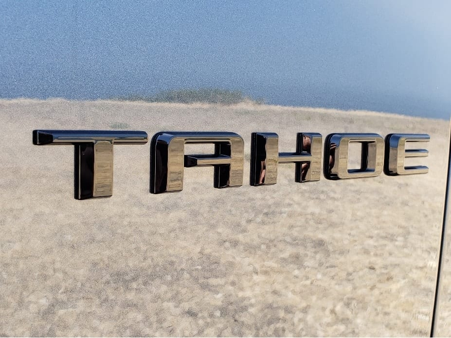 Tahoe badge with ocean reflecting in the paint