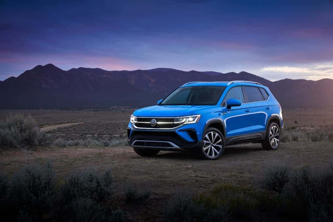 Volkswagen Taos reveal driver front deser and mountain background