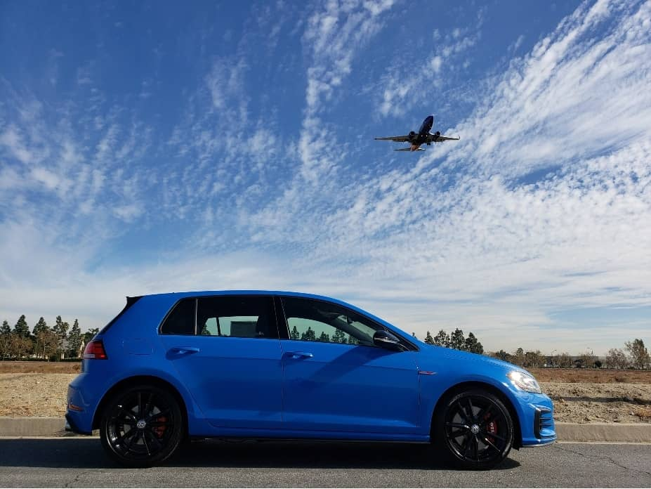 2021 VW Golf GTI passenger profile low.angle w.jet flying