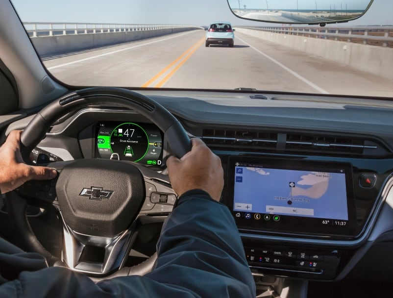 2022 Chevrolet Bolt EUV Reveal cockpit - drivers hands on wheel and road ahead through windshield