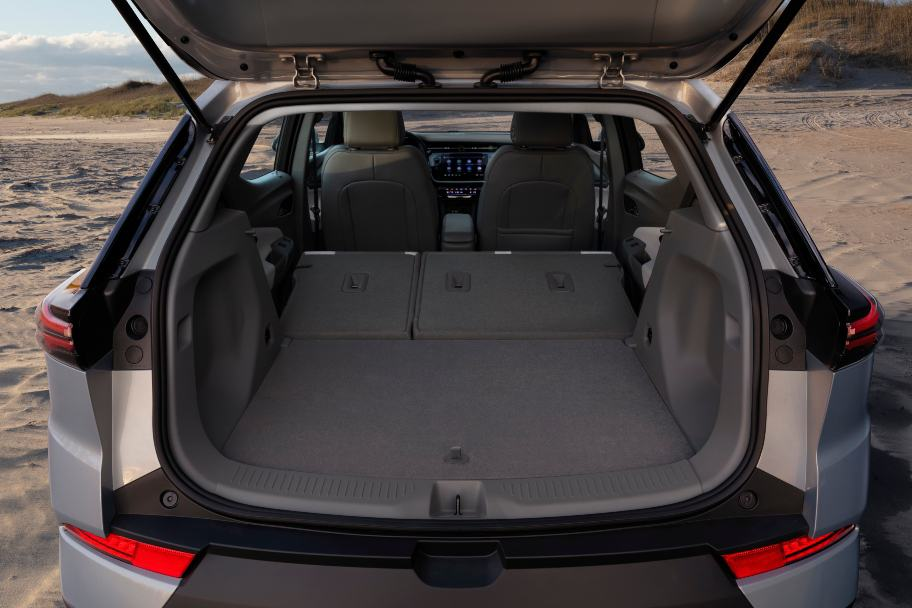 2022 Chevy Bolt EUV cargo area with hatch open and backseats down - gray interior